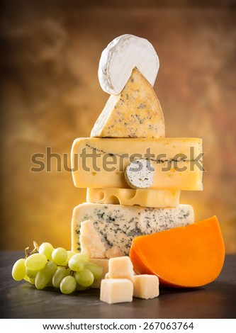 Various types of cheese on stone table, still-life. - stock photo