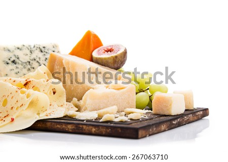 Various types of cheese on white background, still-life. - stock photo