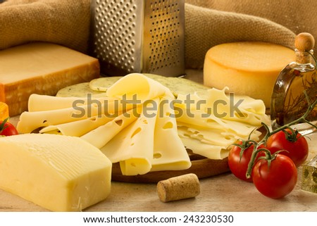 Various types of cheese over a canvas background