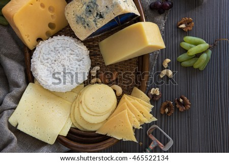 Various types of cheese set with grapes and nuts