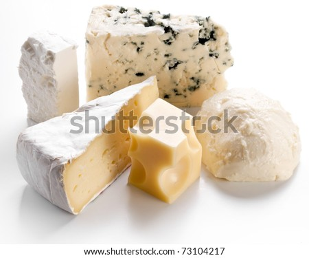 Various types of cheeses on a white background. - stock photo