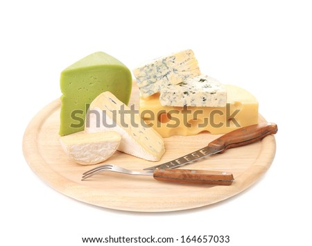 Various types of cheeses on wood. With knife. White background.