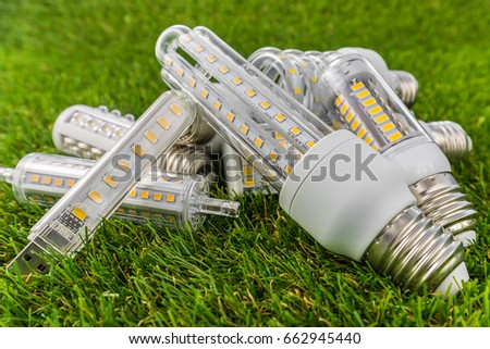 various types of ecological and economical LED bulbs ( E27 similar shape as CFL ) in the green grass