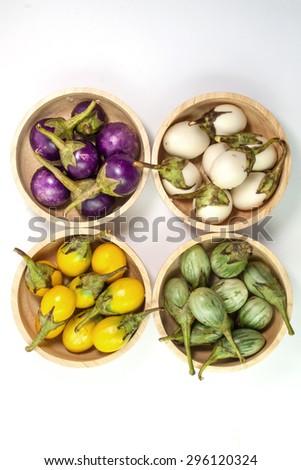 Various types of eggplant, aubergine, eggplant, yellow, white eggplants in bowl on  white background - stock photo