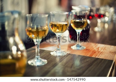 various types of exquisite wine in glasses at dress cocktail party - stock photo