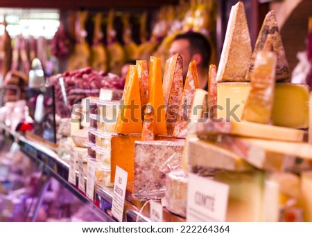 Various types of hard cheeses at Valencia Mercado de Colon historic Market in Valencia, Spain - stock photo