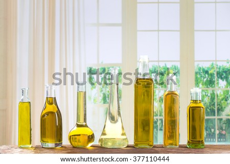 Various types of oil in bottles - stock photo