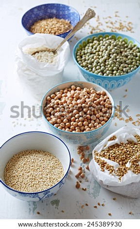 Various types of pulses, rice, quinoa and buckwheat - stock photo