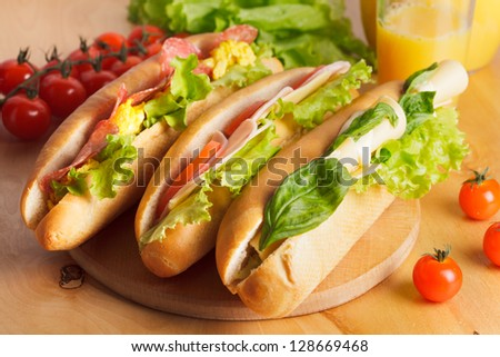 Various types of sandwiches on the table - stock photo