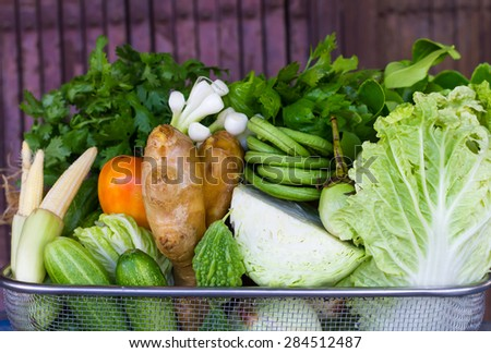 Various types of vegetables on a basket of stainless steel in the shop, one of Thailand.
