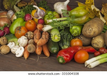 Various types of vegetables on an old wooden table. The concept of diet food. Food for obese patients. Autumn harvest vegetables. Growing fresh home-grown vegetables.  - stock photo