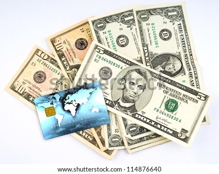 various us dollar bills on pile with credit card - stock photo