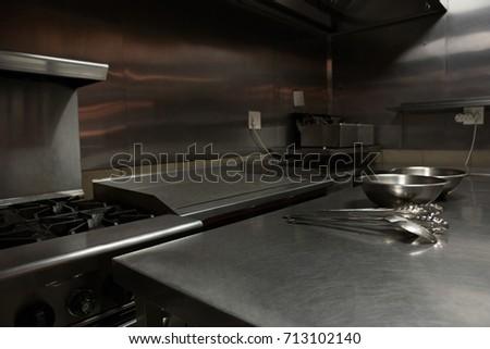 Various Utensils On Worktop In Commercial Kitchen