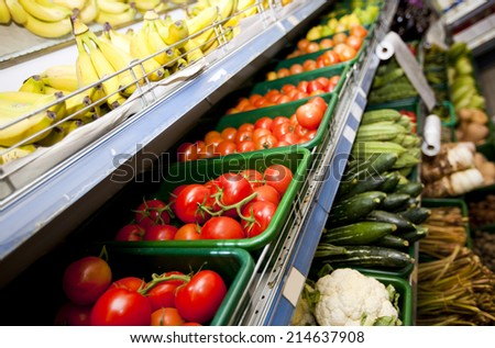 Various vegetables and fruits on display in supermarket - stock photo