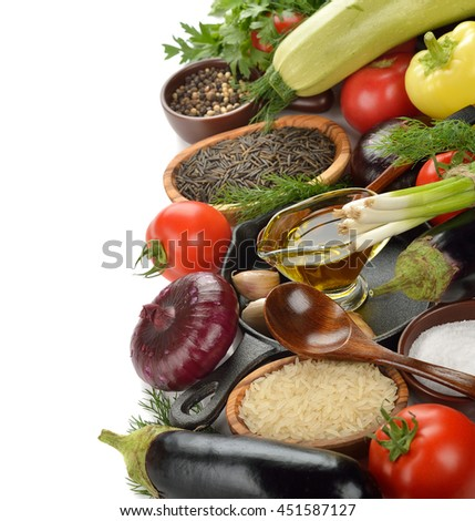 Various vegetables and pan on a white background