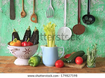 various vegetables and vintage kitchen utensils - stock photo