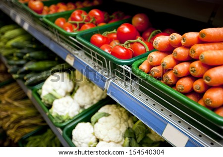 Various vegetables on display in grocery store - stock photo