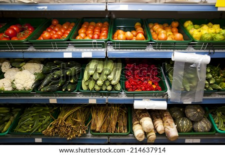 Various vegetables on shelves in grocery store - stock photo