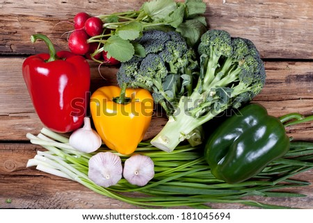 various vegetables on wooden table - stock photo