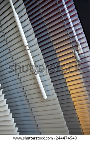 Various venetian blinds in a room - stock photo