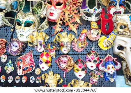 Various venetian masks on sale . colorful artistic masks on the Carnival of Venice - stock photo