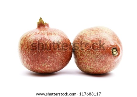 various views of two shiny pomegranates