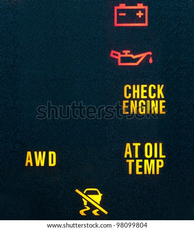 Various warning indicators showing battery, oil, check engine, transmission & traction control signs. Lots of copy space on left. - stock photo