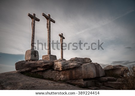 various waterway crossings on stone monolith with cloudy sky - stock photo