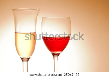 Various wine glasses on pink background