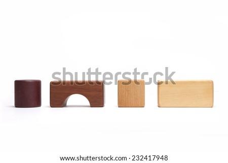 Various wood blocks(oak, walnut, teak, pine) isolated white at the studio. - stock photo