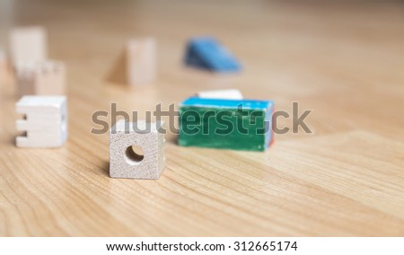 Various wooden cubes on a floor in a kid's room. - stock photo