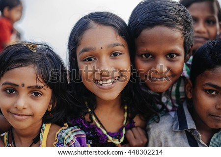 VARKALA, KERALA, INDIA - DECEMBER 15, 2012:  Portrait smiling indian children on Varkala during puja ceremony on holy place - on the Papanasam beach - stock photo