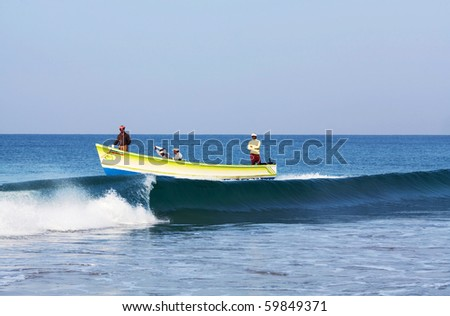 VARKALA, SOUTH INDIA - FEBRUARY 08: Fishing in wooden boat at Arabian sea by local fishermans February 08, 2010 in Varkala, State of Kerala, South India