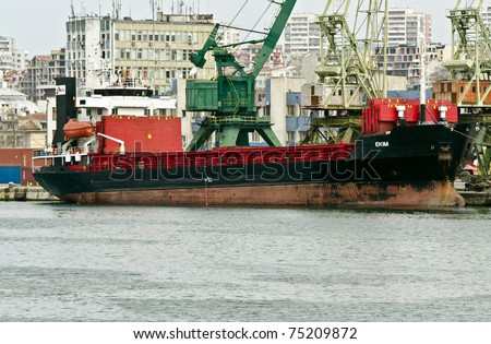 VARNA, BULGARIA - APR 08: Cargo ship EKIM (Year Built: 1979, Flag: Liberia) is loaded with sunflower seed in Port of Varna-East on April 08, 2011 in Varna, Bulgaria.