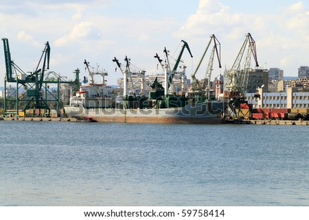 VARNA, BULGARIA - AUGUST  23: Cargo ship HUNTER (Flag: Malta, IMO: 8014239) moored in Port of Varna and being loaded with goods on August 23, 2010 in Varna, Bulgaria.