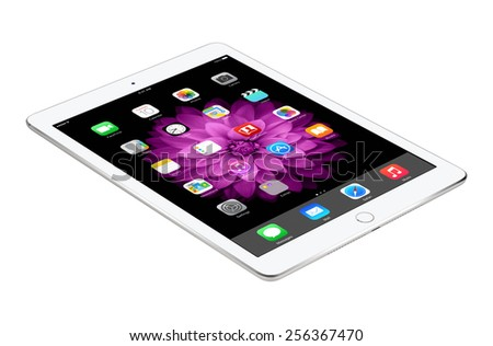 Varna, Bulgaria - February 04, 2014: Apple Silver iPad Air 2 with touch ID displaying iOS 8 homescreen lies on the surface, designed by Apple. Isolated on white background. The whole image in focus. - stock photo