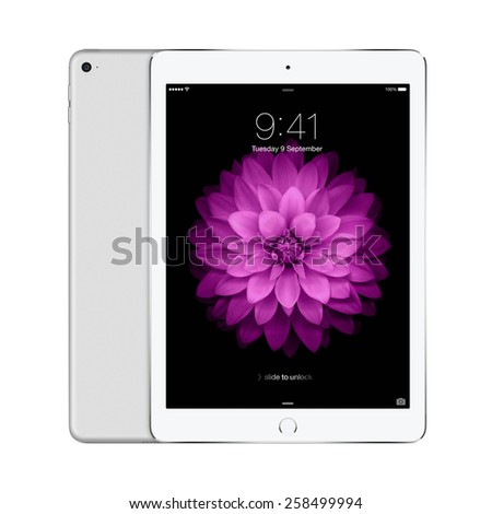 Varna, Bulgaria - February 02, 2014: Front and back sides of Apple Silver iPad Air 2 displaying iOS 8 with lock screen on the display, designed by Apple Inc. Isolated on white background. High quality - stock photo