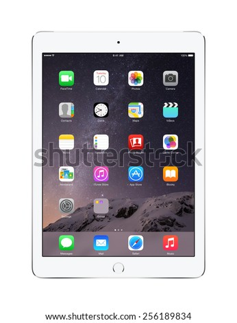 Varna, Bulgaria - February 02, 2014: Front view of Apple Silver iPad Air 2 with touch ID displaying iOS 8 homescreen, designed by Apple Inc. Isolated on white background. High quality. - stock photo