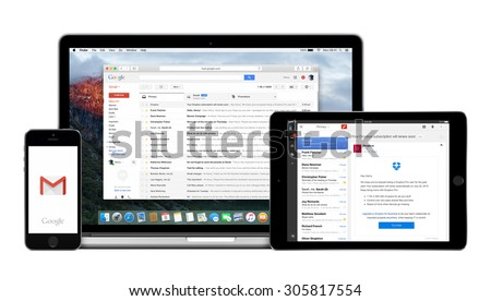 Varna, Bulgaria - February 02, 2015. Google Gmail app on the Apple iPhone iPad displays and desktop version of Gmail on the Macbook Pro. Gmail is a free e-mail service. Multiple devices kit.  - stock photo