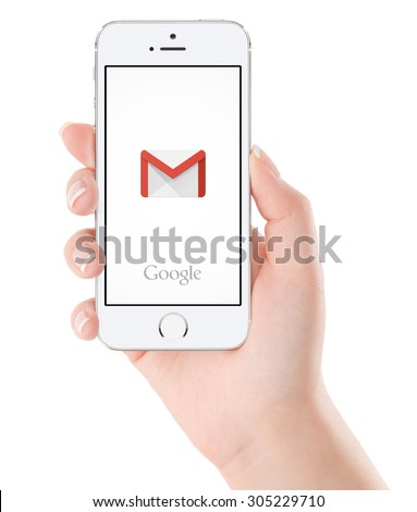 Varna, Bulgaria - February 02, 2015. Google Gmail application logo on the white Apple iPhone 5s display in female hand. Gmail is a free e-mail service provided by Google. Isolated on white background.  - stock photo