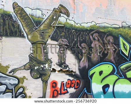 Varna, BULGARIA - February 28, 2015: Street art by unknown artist of a dancing peaple. - stock photo