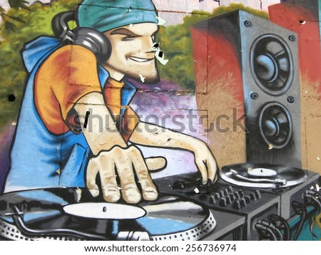 Varna, BULGARIA - February 28, 2015: Street art by unknown artist of a DJ in action.  - stock photo