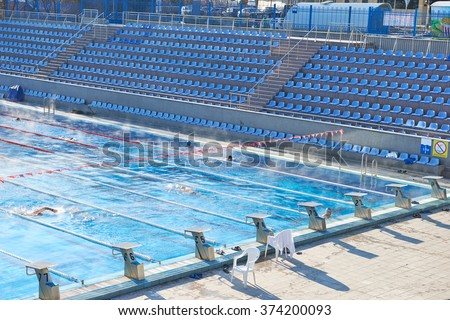 Olympic swimming pool stock images royalty free images - How many meters is a olympic swimming pool ...