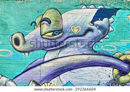 Varna, BULGARIA - June 21, 2015: Street art by unknown artist of a colorful creature close to Port of Varna. - stock photo