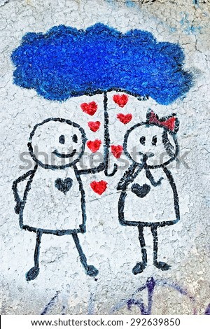 Varna, BULGARIA - June 21, 2015: Street art by unknown artist on a concrete wall close to Port of Varna of a young couple in love. - stock photo