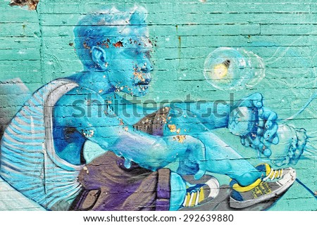 Varna, BULGARIA - June 21, 2015: Street art by unknown artist on a concrete wall close to Port of Varna. Close up of old man with smart sneakers holding a jellyfish.  - stock photo