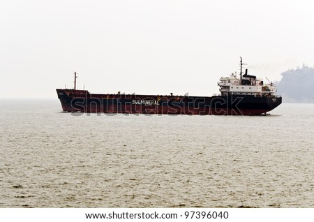 VARNA, BULGARIA - MARCH 11: Cargo ship BATYA (ex DURRINGTON), Year Built: 1981, Flag: Bulgaria sails away after a short stay at MTG-DOLPHIN for conversion work on March 11, 2011 in Varna, Bulgaria. - stock photo