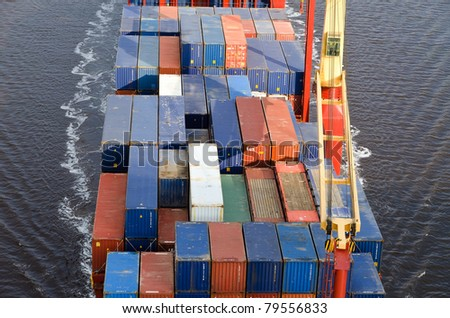 VARNA, BULGARIA - MAY 13: Cargo ship ALEXANDER SIBUM (Flag: Antigua Barbuda, Year Built: 2006) sails to Port of Varna-West to load containers on May 13, 2011 in Varna, Bulgaria. - stock photo