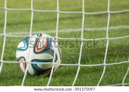 Varna, BULGARIA - MAY 30, 2015: Close-up official FIFA 2014 World Cup ball (Brazuca) in the goal (net). Adidas, a major German company