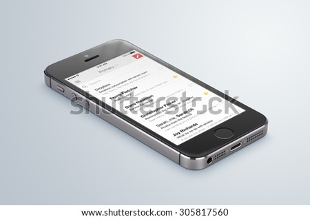 Varna, Bulgaria - May 31, 2015. Google Gmail app logo on the black Apple iPhone 5s display that lies on the surface. Gmail is a free e-mail service provided by Google. Isolated on white background.  - stock photo